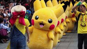 Japanese Character Parade At Yokohama, Japan. Pika parade around excited crowds at yokohama pokemon fest, yearly event where the popular character covers the stock video