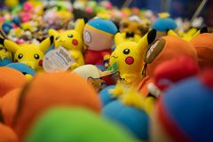 Pikachu and southpark toys in the arcade machine stock photos