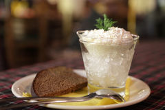 Pike caviar with black bread on a plate Stock Photography