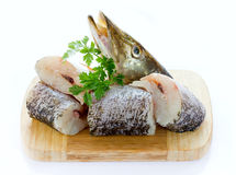 Pike fish pieces on wooden board isolated on white background Royalty Free Stock Image