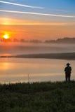Pike-Jäger auf dem Fluss Stockbilder