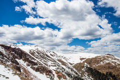 Pike Peak Summit - Colorado Landscape. Snow cap mountain view near the summit of Pikes Peak under a blue sky with white clouds. Pikes Peak is one of the top Stock Photography
