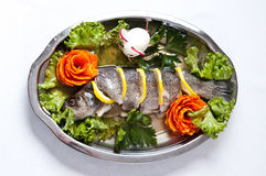 Pike perch elegant dish served. Elegant dish of pike perch served with lemon, carrot and decorated egg royalty free stock images