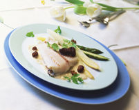 Pike-perch fillet. With morels and white and green asparagus stock photography