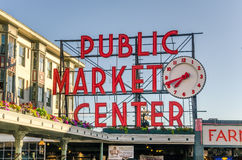 Pike Place Market Neon Sign at sunset Stock Photo