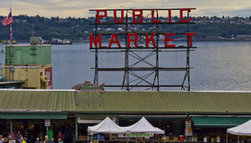 Pike Place Market Sign. Pike Place Market is a public market overlooking the Elliott Bay waterfront in Seattle, Washington, United States. The Market opened Royalty Free Stock Image