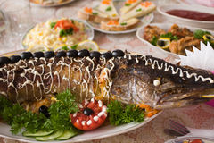 Pike prepared fish. And some salads behaind Royalty Free Stock Photography