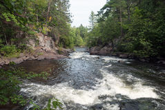 Pike River near Dave`s Falls, Wisconsin, USA. Pike River is a tributary of the Menominee River and flows through Marinette County, Wisconsin, USA royalty free stock images