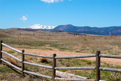 Pikes Peak at a distance. A wide angle shot of Greeland Open Space with wooden fence in foreground and snowcovered Pikes Peak in the background Royalty Free Stock Photos