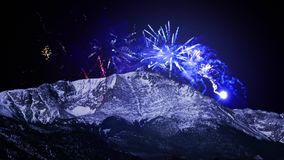 Pikes Peak Fourth of July. This video features Pikes Peak in Colorado Springs against a deep blue sky with fireworks exploding in the distance stock video footage