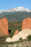 Pikes Peak from the Garden of the Gods. This is a view of Pikes Peak framed by the red rock formations of the Garden of the Gods. Pikes Peak is noted for being Royalty Free Stock Photo