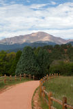 Pikes Peak from a Garden of the Gods Trail. The view of Pikes Peak from a paved trail in the central garden at Garden of the Gods Stock Photo