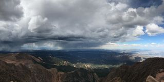 Pikes Peak Colorado Springs rain and thunder storm. Pikes Peak, located in the Rocky Mountains, is one of the most famous summits in the United States. The 14 Stock Image