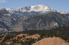 Pikes Peak over Garden of the Gods Park in Winter. Pikes Peak standing over Garden of the Gods red rocks in the winter. Located in Colorado Springs, Colorado Royalty Free Stock Photos