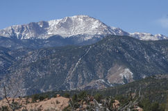 Pikes Peak over Garden of the Gods Park in Winter. Pikes Peak standing over Garden of the Gods red rocks in the winter. Located in Colorado Springs, Colorado Royalty Free Stock Images