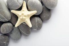 piękna ciała elementów masażu mleka naturalni zdroju kamienie Fotografia Stock