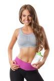 Piękna kobieta trzyma butelkę proteinowy potrząśnięcie Obrazy Stock