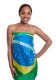 Piękna kobieta w brazylijskiej flaga Zdjęcie Royalty Free