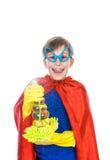 Piękny rozochocony dziecko ubierał jako nadczłowieka cleaning z gąbką i modlitwą Obraz Stock