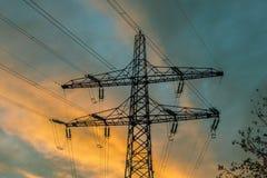 Pilão da eletricidade no por do sol Imagem de Stock Royalty Free