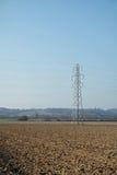 Pilão da eletricidade/torre da transmissão Foto de Stock Royalty Free