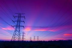 Pilões da eletricidade no por do sol Fotos de Stock Royalty Free