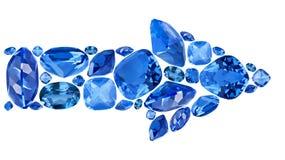 Pil från blåa safirädelstenar som isoleras på vit Royaltyfria Bilder