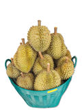 Pila aislada de Durian o de rey de frutas en la cesta para la venta en el mercado en el fondo blanco Imagenes de archivo