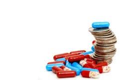 Pila aumentante di quarti e di droghe Fotografia Stock