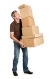 Pila d'equilibratura dell'uomo di consegna di caselle Fotografia Stock Libera da Diritti