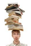 Pila d'equilibratura di libri sulla testa Immagine Stock Libera da Diritti