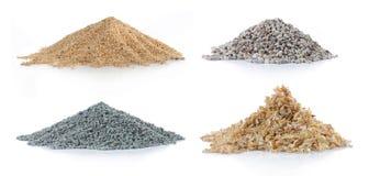 Pila de arena, de madera de pino, de carbón verde y de roca Foto de archivo libre de regalías
