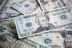 Pila de billete con el foco en los $20 Imagen de archivo libre de regalías