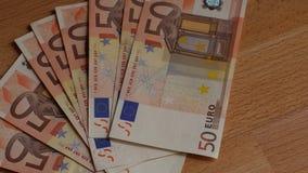 Pila de billetes de banco euro de papel almacen de metraje de vídeo