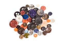 Pila de botones aislados Imágenes de archivo libres de regalías
