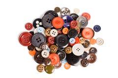 Pila de botones aislados Fotos de archivo libres de regalías