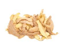 Pila de cáscaras de patata aisladas Imágenes de archivo libres de regalías
