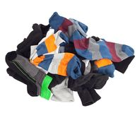 Pila de calcetines sin clasificar. Aislado en blanco Fotografía de archivo libre de regalías