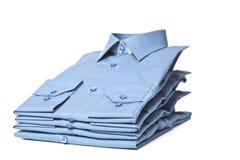 Pila de camisas azules Foto de archivo libre de regalías