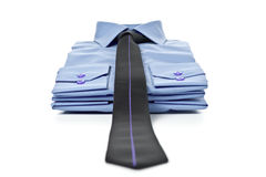 Pila de camisas azules Imagen de archivo libre de regalías