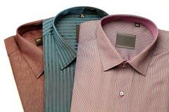 Pila de camisas formales Imágenes de archivo libres de regalías