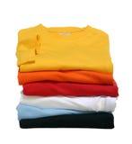 Pila de camisetas Imagenes de archivo