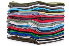 Pila de camisetas limpias Imagen de archivo libre de regalías