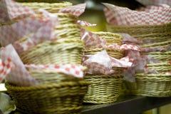 Pila de cestas con el papel a cuadros Foto de archivo