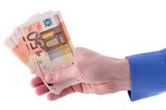 Pila de cincuenta billetes de banco euro a disposición Imagenes de archivo