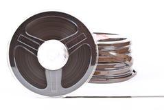 Pila de cintas audios de los carretes fotos de archivo