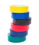 Pila de cintas eléctricas de diverso color Fotografía de archivo libre de regalías