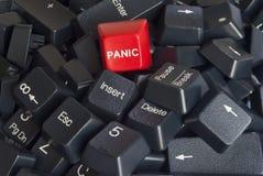 Pila de claves de teclado con el botón de pánico rojo Fotografía de archivo