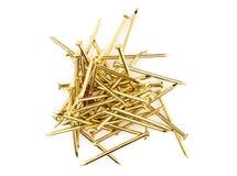 Pila de clavos de oro Imágenes de archivo libres de regalías