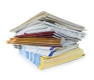Pila de compartimientos y de periódicos Imagen de archivo libre de regalías